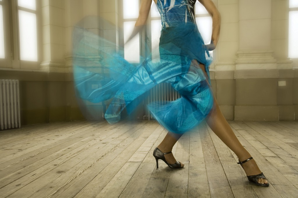 Dancer legs in a blue dress, in a Dance School hall, Buenos Aire